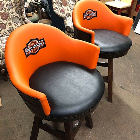 Harley Davidson logo on bar stool using quality furniture reupholstery by HAMS Upholstery in Aston, PA